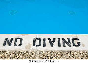 Shallow End - Warning sign at the edge of a swimming pool.