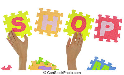 "Hands forming word ""Shop"" with jigsaw puzzle pieces isolated"