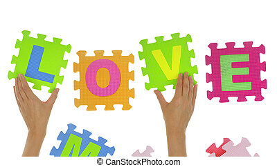 "Hands forming word ""Love"" with jigsaw puzzle pieces isolated"