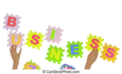"Hands forming word ""Business"" with jigsaw puzzle pieces isolated"