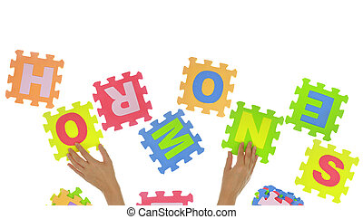 Hands forming word quot;Hormonesquot; with jigsaw puzzle...