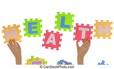 Hands forming word quot;Healthquot; with jigsaw puzzle...