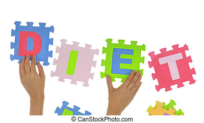 "Hands forming word ""Diet"" with jigsaw puzzle pieces isolated"
