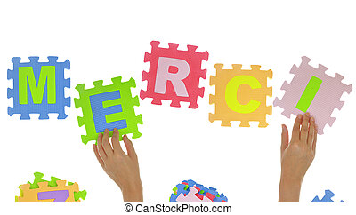 "Hands forming word ""Merci"" with jigsaw puzzle pieces..."