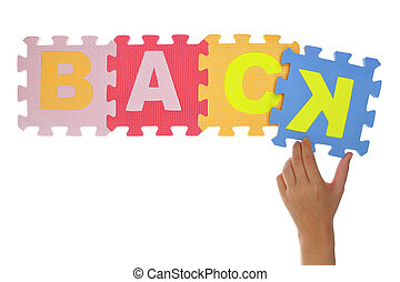 "Hand forming word ""Back"" jigsaw puzzle pieces isolated"