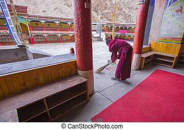 monk - Young monk doing clean inside chapel in temple , Leh...
