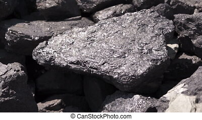 Carbon Graphite Ore Tilt Up - Shallow depth of field, tilt...