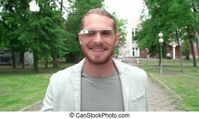 Multitasking - Tracking shot of man wearing google glass...