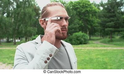 Futuristic Intelligence - Business-like man walking along...
