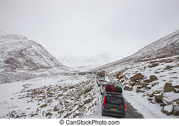 Traffic jam in snow road in mountain