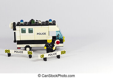 police - Toy police in a white background
