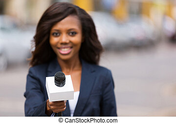 young african female journalist interviewing - portrait of...