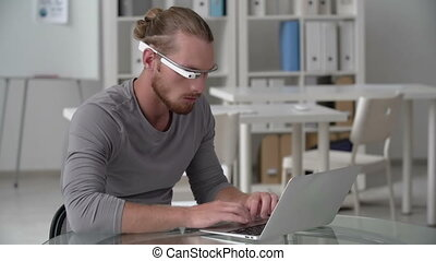 Multiple Device Choice - Man using smart eyewear computer...