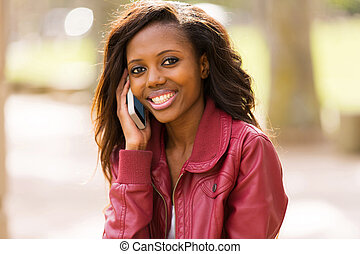 african girl talking on cell phone