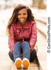 african woman sitting outdoors - stylish african woman...