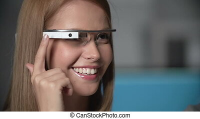 Innovations - Close up of smiley girl using smart eyewear in...