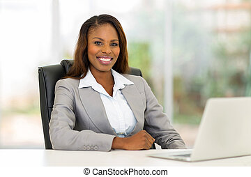 african american businesswoman in office - happy african...