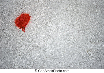 White wall with red paint