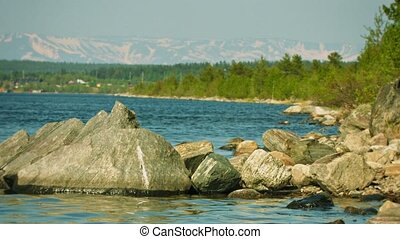 Shore of Lake Imandra and Khibiny mountains on the horizon -...