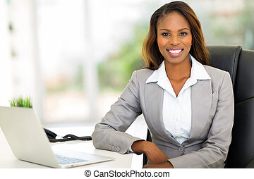 young afro american businesswoman sitting in office -...