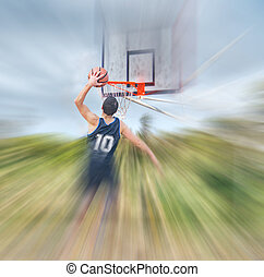 blurred dunk - basketball player dunking in a blurred...