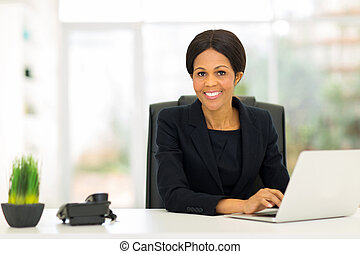 mature afro american business woman using computer -...