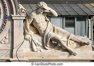 Statue of a man on a building in Milan
