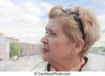Portrait of a woman in the city