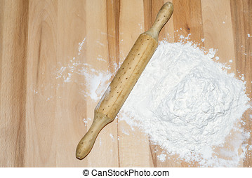 Flour and rolling pin on wood, with room for text entry
