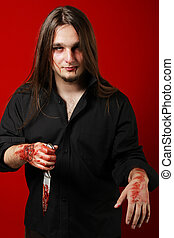 Crazy man with a knife and blood