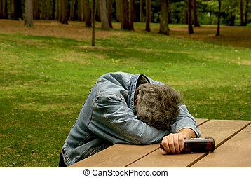 drunk man in park - man passed out at picnic bench after...