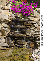 Ornamental waterfall with flowers