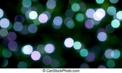 Blurred blue, green and violet lights and sparkles -...