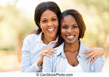 middle aged african mother and adult daughter
