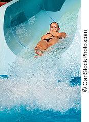 Woman at water park - Woman having fun, sliding at water...
