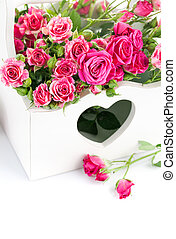 bouquet pink roses in wooden basket isolated on white...