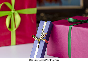 Wrapped gifts - Three gift boxes wrapped in unicolored...
