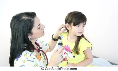 Attractive doctor examining patients ears at the hospital