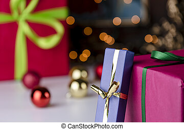 Gifts and glitter balls - Wrapped gifts contrasting with...