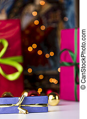 Gifts and twinkles - Solemnly wrapped gifts in unicolored...