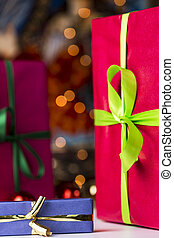 Presents and twinkles - A blue gift box with golden bow in...