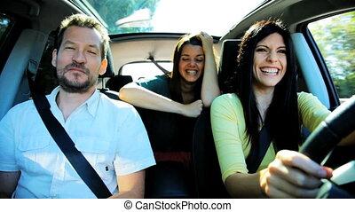 Three people in car having fun - Two beautiful woman and one...