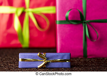 Three presents, bows and ribbons - The golden bow and blue...