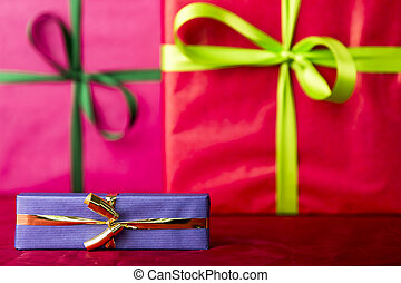 Blue gift with golden bowknot - Two big presents wrapped in...