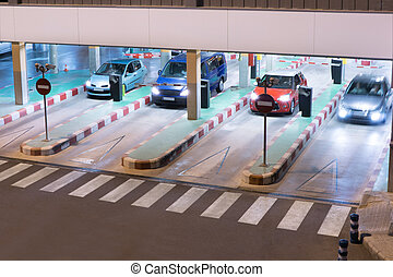 Airport Parking Garage - Cars exiting a parking garage at...