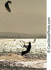 kite surfing - man doing kite surfing or kiteboarding