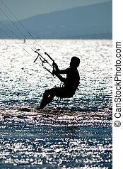 kite surfing - man doing kite surfing or kiteboarding