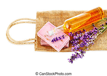Bunch of lavender flowers,soap and oil isolated on whiteSpa...