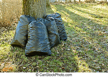Plastic garbage bags - Black plastic garbage bags after the...