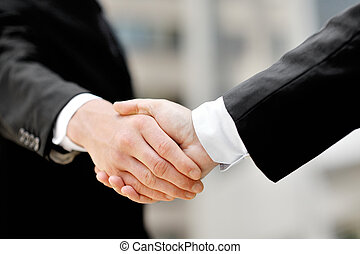 businessmen shaking hands - business deal partnership...